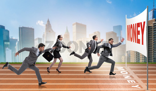 Business people running towards money goal