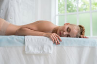 Girl relaxing after massage in spa salon