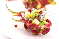 Half pitahaya filled with fruit salad