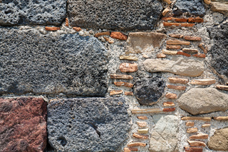 detail of wall of ancient castle in Calatabiano