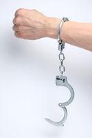 Handcuffs on man's wrist