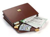 Stock market portfolio concept. Briefcase with capital stocks, bonds, gold and money isolated on white background.