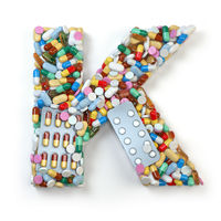 Letter K. Set of alphabet of medicine pills, capsules, tablets and blisters isolated on white.