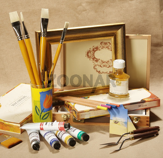 Paints, brushes and canvas