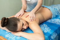 Young girl lying on her stomach having massage