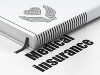 Insurance concept: book Heart And Palm, Medical Insurance on white background