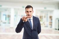 Realtor or entrepreneur making watching you gesture