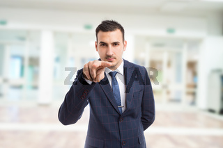 Realtor or entrepreneur making watching you gesture