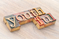 youthful word abstract in wood type
