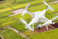 Unmanned Aircraft System (UAV) Quadcopter Drone In The Air Over Hanalei Valley and Taro Farm Fields on Kauai, Hawaii.