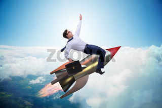 Businessman flying on rocket in business concept