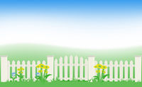 Grass and fence under blue sky.