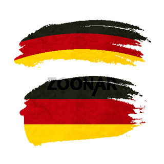 Grunge brush stroke with Germany national flag on white