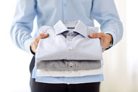 close up of businessman holding shirts