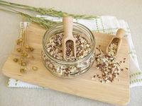 Seed mixture in jar with rolled oats, flaxseeds and sesame