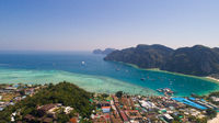 Aerial drone photo of Andaman sea and limestones, shot done behind iconic tropical beach and resorts of Phi Phi island
