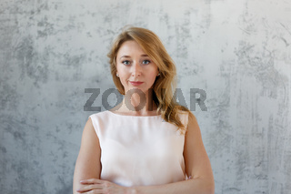 Long -haired beautiful girl in dress