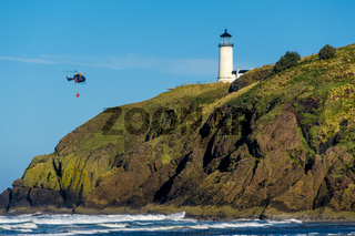 North Head Lighthouse. Coast guard helicopter in the sky.