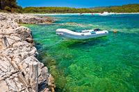 Idyllic rocky beach Sakarun and small boat on Dugi Otok island