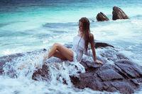Beautiful woman on the rock