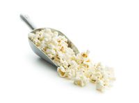 Tasty popcorn in metal scoop.