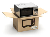 Microwave oven in carton cardboard box. E-commerce, internet online shopping and delivery concept.