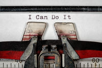 Macro of the ribbon and paper of typewriter with positive confident message