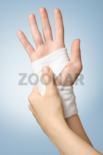 Injured hand with bandage