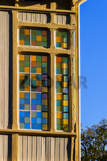 Colorful stained glass window of a house