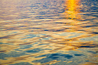 Colorful water surface at sundown