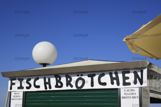 fishburger ad on hut at the beach of Heringsdorf