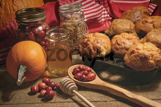 Muffins with fresh cranberries on table