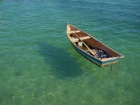 small row boat floating on the water small row boat floating on the water