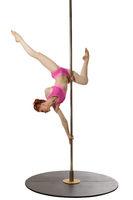 Redhead gymnast posing upside down on pylon