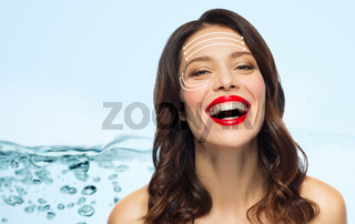 beautiful laughing woman with face lifting arrows