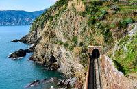 Railway along the Ligurian coast leading to Vernazza village. Cinque Terre, Italy