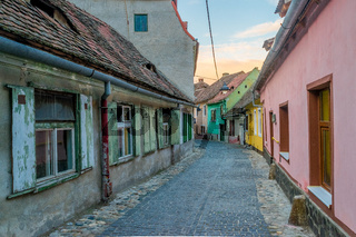 View to a narrow street with colourfull houses in Sibiu