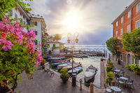 Sunrise at the port of Limone on lake Garda, Brescia, Lombardy, Italy