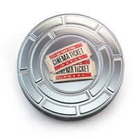 Movie, cinema or video vintage concept. Tickets on retro film reel or canister.