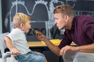 Cute little boy at speechtherapist session.