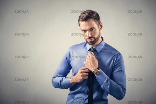 Young handsome man portrait. Confident, sexy pose