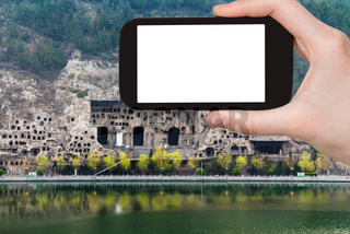 tourist photographs Longmen Grottoes in China