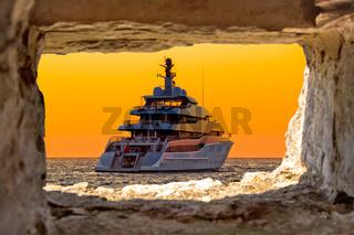 Luxury yacht through stone window view