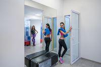 Sexy girls posing in locker room of fitness center