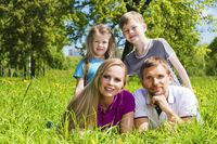 Family on grass in summer park