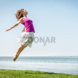 Girl jumping on the lake