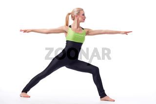 Attractive female gymnast exercising at studio
