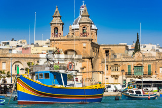 Coloful boats in Marsaxlokk port in Malta