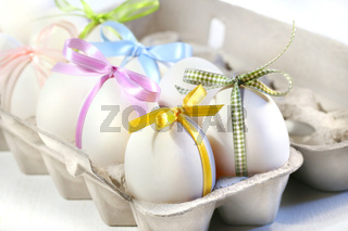 White eggs with colored ribbons