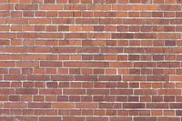 stained red brick wall for backgrounds